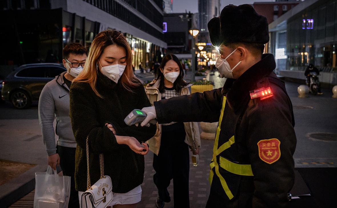 Доносы на соседей и камеры: как в Китае следят за соблюдением карантина
