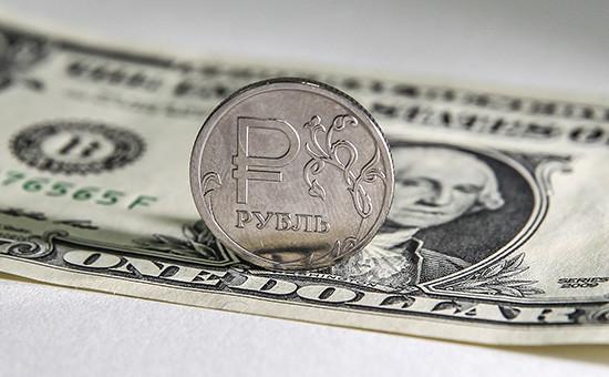 Банковские аналитики спрогнозировали рост курса доллара выше 70 рублей