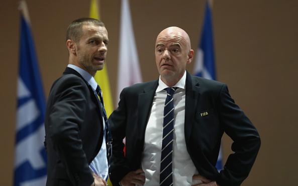 Президент УЕФА Александер Чеферин (слева) и президент ФИФА Джанни Инфантино (справа)