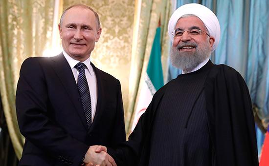 Владимир Путин (слева) иХасан Роухани