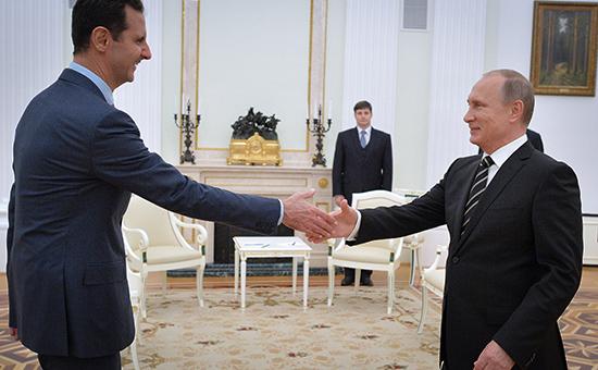 Президент РФ Владимир Путин иего сирийский коллега Башар Асад. Москва, Кремль, октябрь 2015года