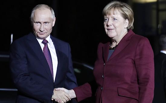 Президент России Владимир Путин и канцлер Германии Ангела Меркельв Берлине