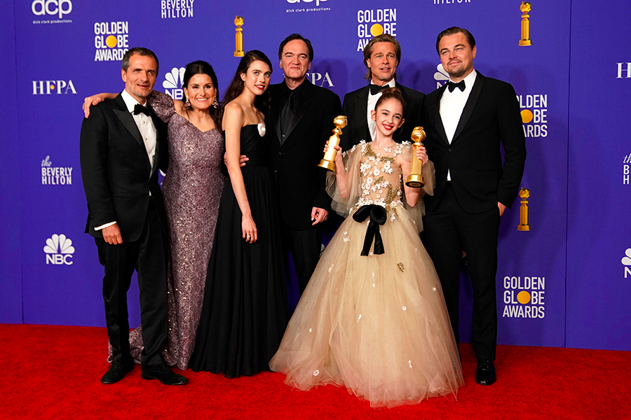 """77th Golden Globe Awards - Photo Room - Beverly Hills, California, U.S., January 5, 2020 - The cast of """"Once Upon A Time...In Hollywood"""" poses backstage with their award for Best Motion Picture - Musical or Comedy. REUTERS/Mike Blake"""