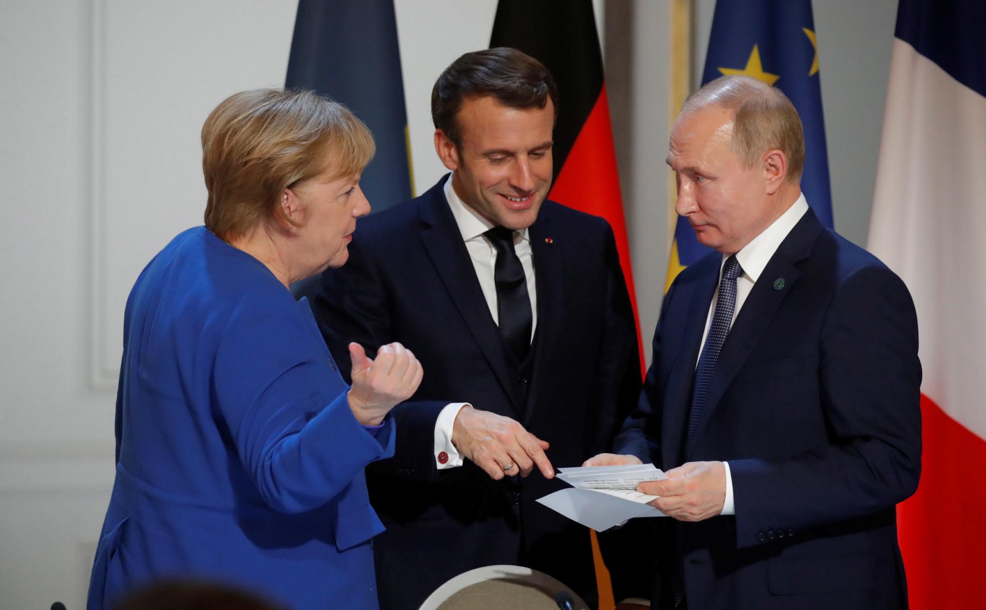 Ангела Меркель, Эмманюэль Макрон и Владимир Путин