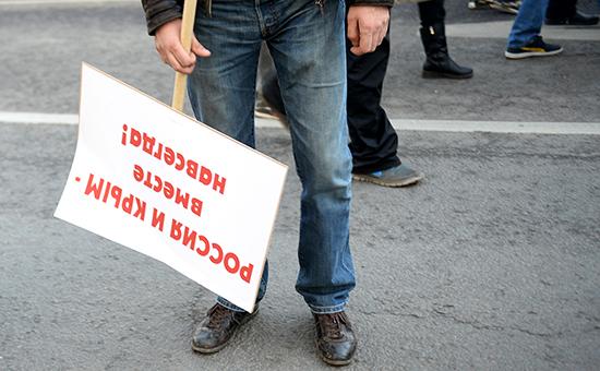 Участник митинга-концерта «Мы вместе», посвященного годовщине присоединения Крыма к России