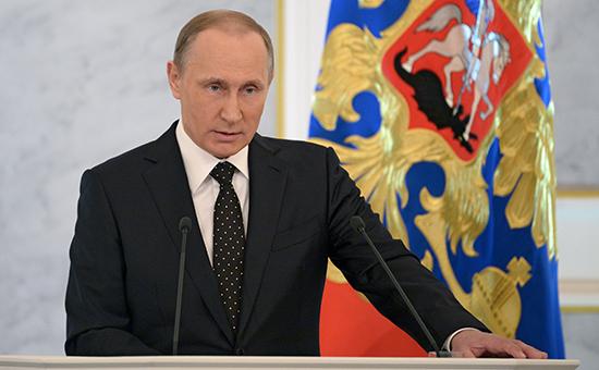 Президент России Владимир Путин вовремя оглашения ежегодного Послания президента Российской Федерации Федеральному собранию. 3 декабря 2015 года