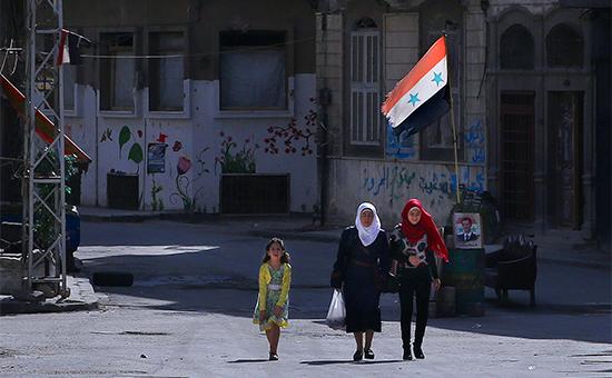 Местные жители наодной изулиц Хомса