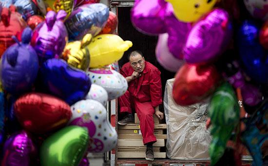 Продавец воздушных шариков на улице Пекина