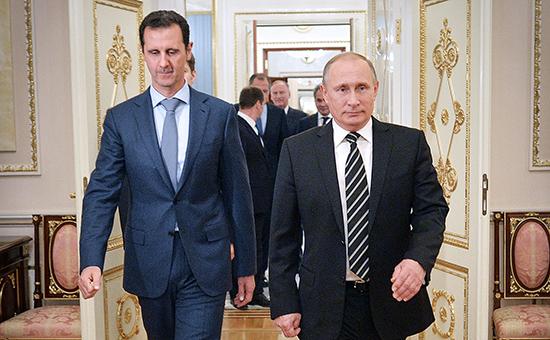 Президент Сирии Башар Асад и президент России Владимир Путин (слева направо) во время встречи в Кремле, 21 октября 2015 года