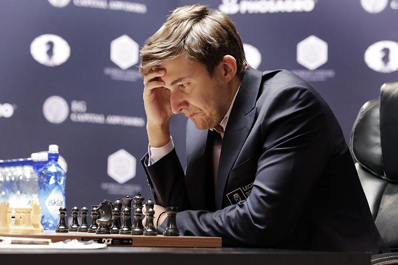 Сергей Карякин,Sergey Karjakin studies the board during round 8 of the World Chess Championship against Magnus Carlsen, in New York, Monday, Nov. 21, 2016