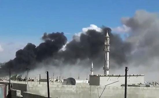 Дым над городомТелль-Бисапосле бомбардировки