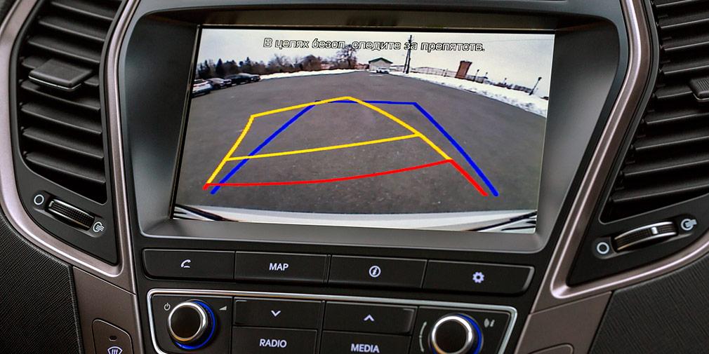 Картинка стандартной камеры заднего вида с динамическими подсказками, но качество среднее.
