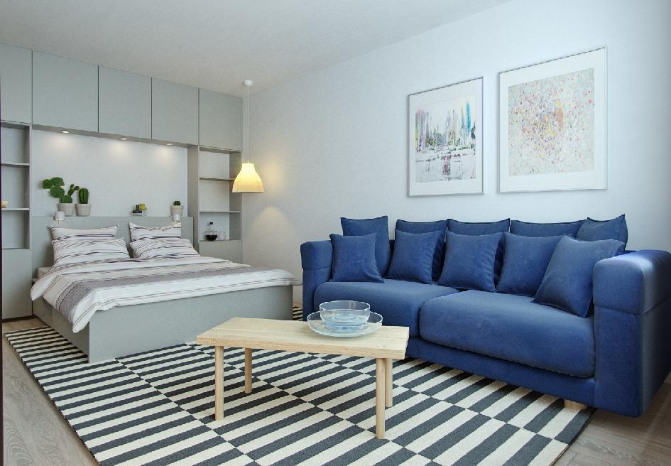 Интерьер квартиры получился сдержанным: нейтральный фон разбавляют яркие цветовые акценты, например, диван глубокого синего цвета