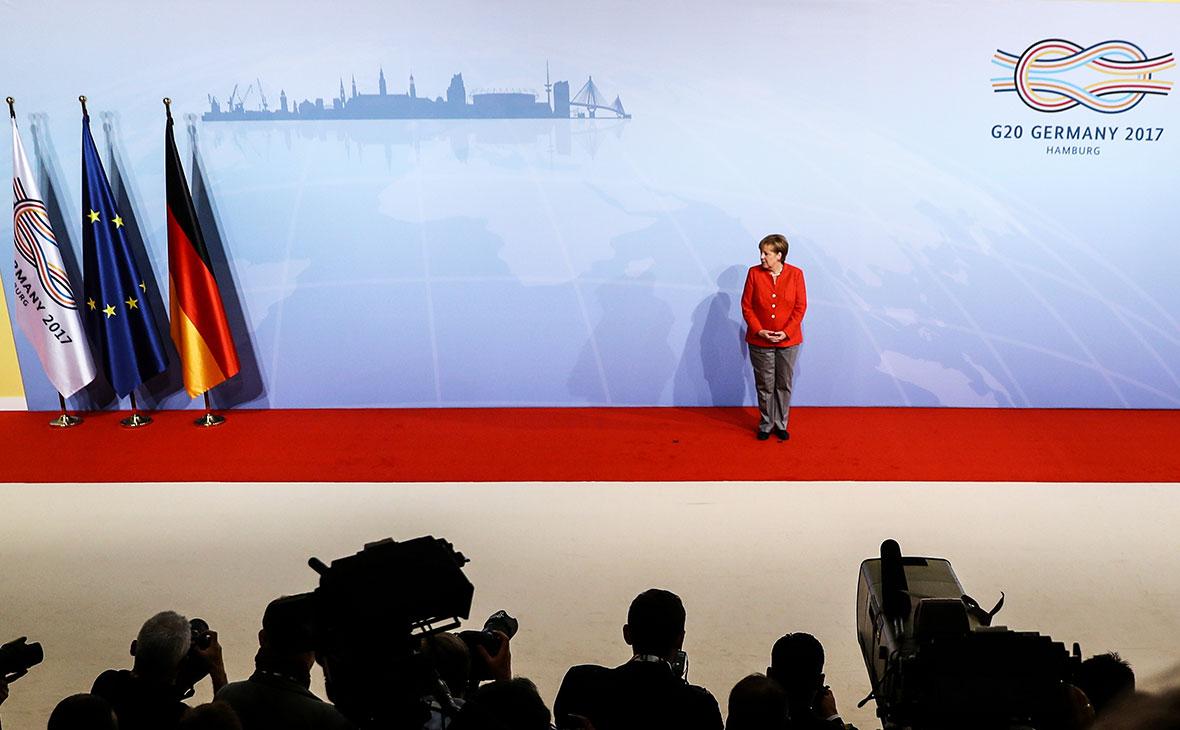 Ангела Меркель встречает гостей на саммите G20