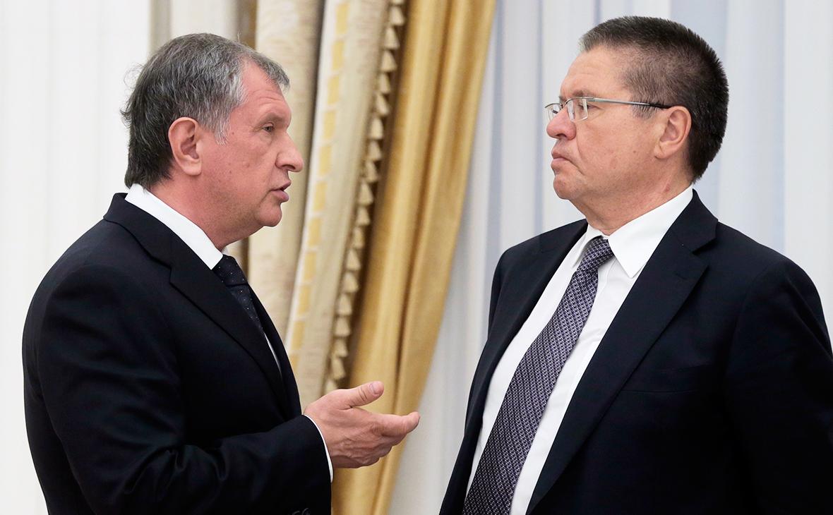 Игорь Сечин и Алексей Улюкаев (слева направо)