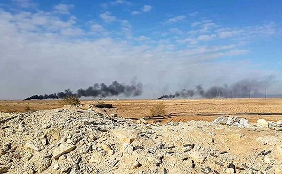 Дым над позициямитеррористической группировки «Исламское государство» послеавиаудара