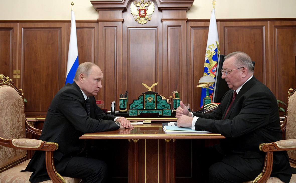 Владимир Путин и Николай Токарев (слева направо)
