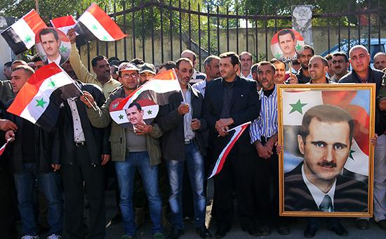 Сторонники президента БашараАсада,члены отрядов народной самообороны Сирии