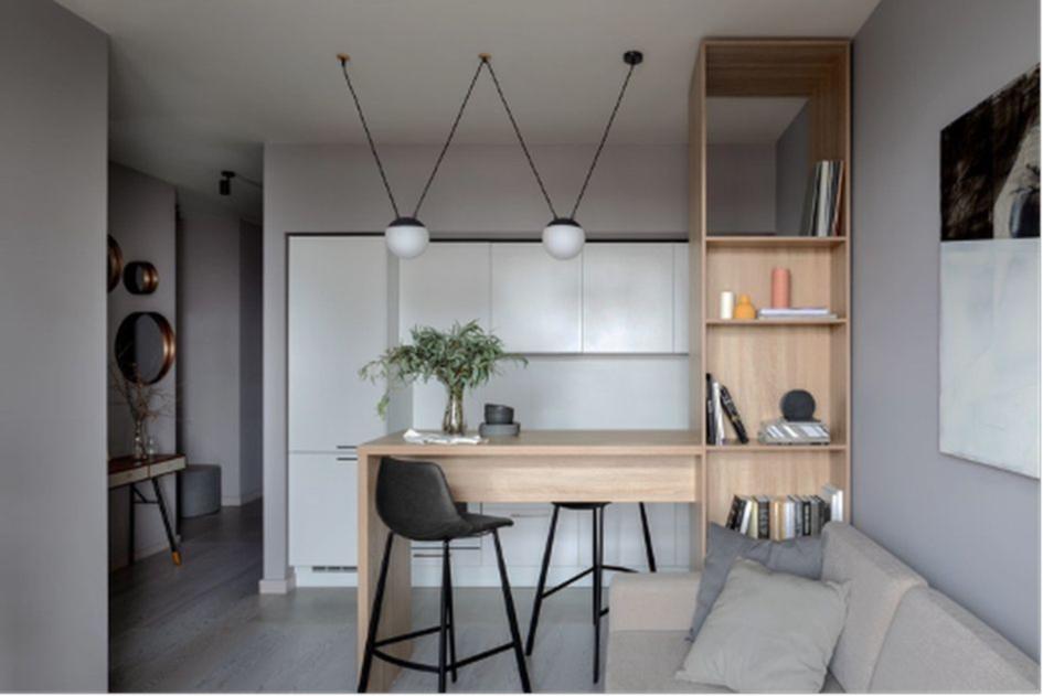 Барная стойка поможет отделить зону кухни в студии