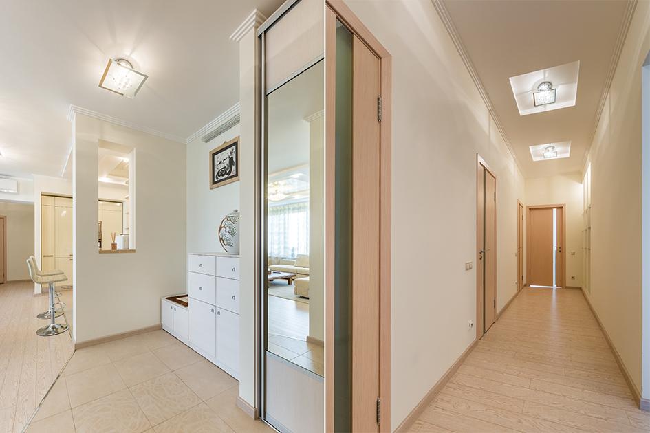 Лейтмотив интерьера кухни, гостиной и коридора — сливочные оттенки с глянцевыми фасадами. Строгую геометрию прямых линий уравновешивает изогнутая люстра