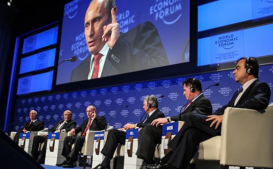 Владимир Путин (третий слева) во время официальной церемонии открытия ежегодной сессии Всемирного экономического форума (ВЭФ) в Давосе. 28 января 2009 года
