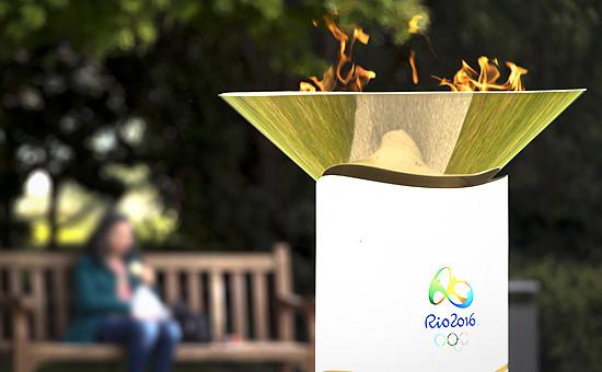 Олимпийский огонь у музеяОлимпийских игр в Лозанне перед эстафетой в Рио-де-Жанейро, апрель 2016 года