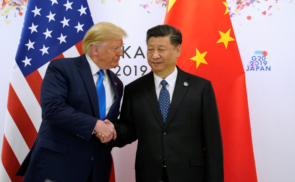 Дональд Трамп и Си Цзиньпин (слева направо)