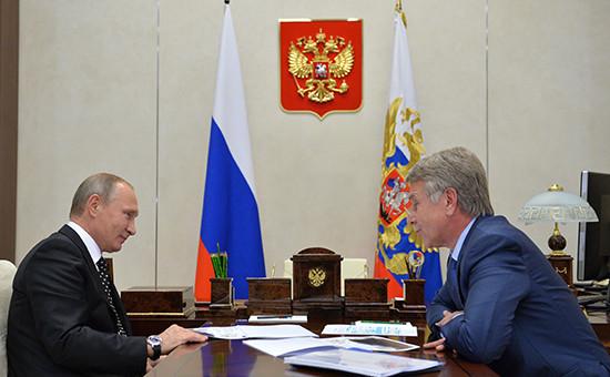 Президент России Владимир Путин исовладелец НОВАТЭКа Леонид Михельсон. 14 ноября 2016 года