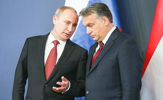 Президент России Владимир Путин и премьер-министр Венгрии Виктор Орбан во время церемонии подписания ряда соглашений между странами 17 февраля 2015 года в Будапеште