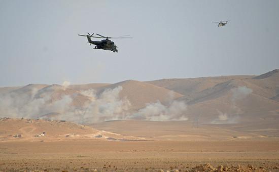Вертолеты сирийской армии в окрестностях Пальмиры в Сирии. Фото 8 марта 2016 г.