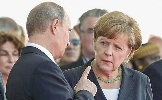 Канцлер Германии Ангела Меркель(справа) и президент России Владимир Путин(слева)