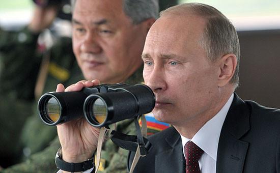 Президент России Владимир Путин иминистр обороны РФ Сергей Шойгу. Архивное фото