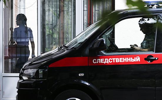 У здания Главного следственного управления СК РФ по Москве, где проходят обыски, 19 июля 2016 года