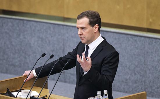 Премьер-министр РФ Дмитрий Медведев во время выступления с отчетом о результатах деятельности правительства РФ за 2014 год