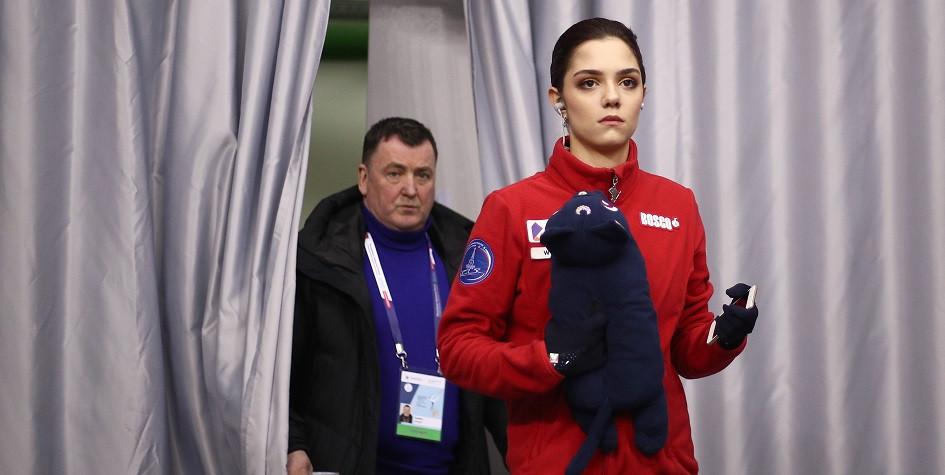 Двукратная чемпионка мира по фигурному катанию Евгения Медведева (справа) со своим тренером Брайаном Орсером
