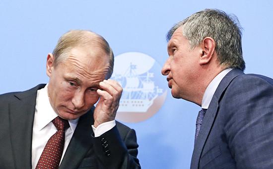 Президент России Владимир Путин и президент «Роснефти» Игорь Сечин (слева направо)