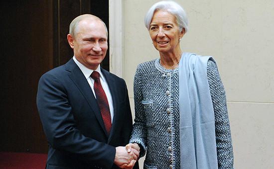 Президент России Владимир Путин и глава Международного валютного фонда Кристин Лагард на встрече в рамках Делового саммита форума АТЭС