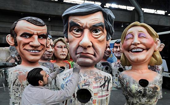 Фигуры, изображающие кандидатов в президенты ФранцииЭмманюэля Макрона,Франсуа Фийона иМарин Ле Пен (слева направо)