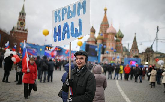 Участник митинга-концерта «Мы вместе», посвященного годовщине воссоединения Крыма с Россией. 18 марта 2016 года