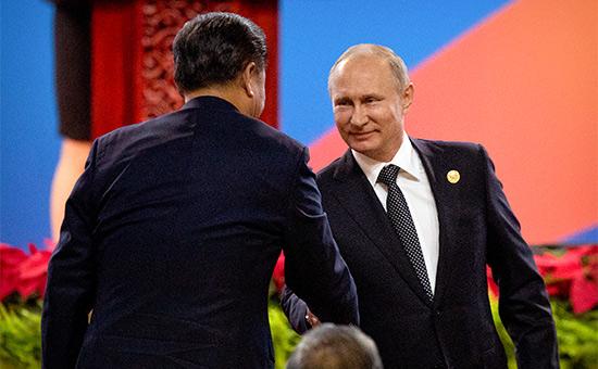 Си Цзиньпин иВладимир Путин (слева направо) наоткрытии форума «Один пояс, один путь»