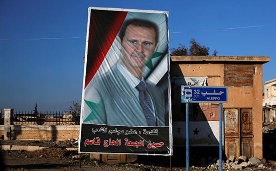 Портрет президента Сирии Башара Асада впригороде Алеппо. Декабрь 2016 года