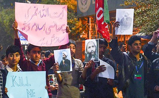 Пакистанские студенты во время протеста против казнишиитского лидера Нимра аль-Нимра