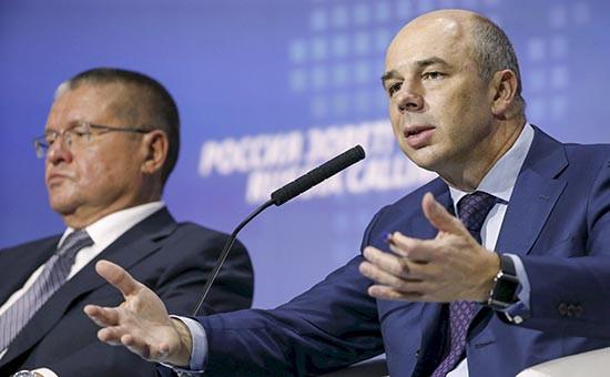 Министерство Антона Силуанова (справа) отказалось финансировать сельское хозяйство и научные исследования согласно антикризисному плану правительства