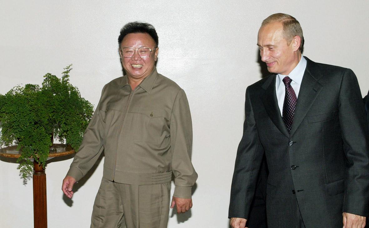 Владимир Путин иКим Чен Ир (слева)