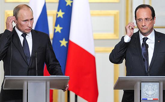 Президент России Владимир Путин (слева) и президент Франции Франсуа Олланд (справа). Архивное фото