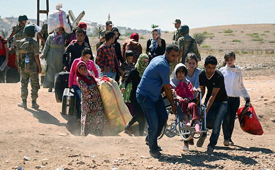 Сирийские беженцы в районесирийско-турецкой границы. Сентябрь 2014 года