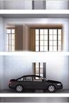 Фото: Porsche построит люксовый дом-гараж с парковочными роботами