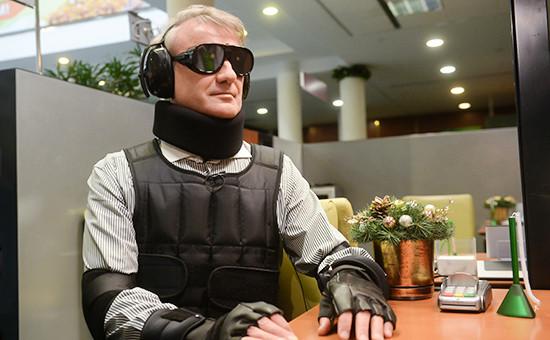 Глава Сбербанка Герман Греф в специализированном костюме Gert