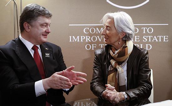 Президент Украины Петр Порошенко и глава МВФ Кристин Лагард во время встречи в рамках 45-го Всемирного экономического форума. Архивное фото