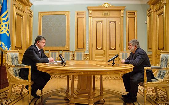 Президент Украины Петр Порошенко и уволенный с поста губернатора Днепропетровской области Игорь Коломойский  (слева направо)